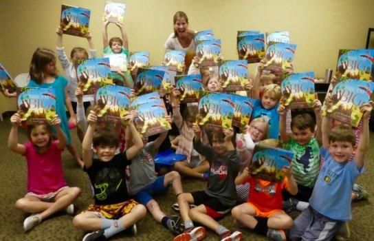 Kat Kronenberg Dream Big Book Held High