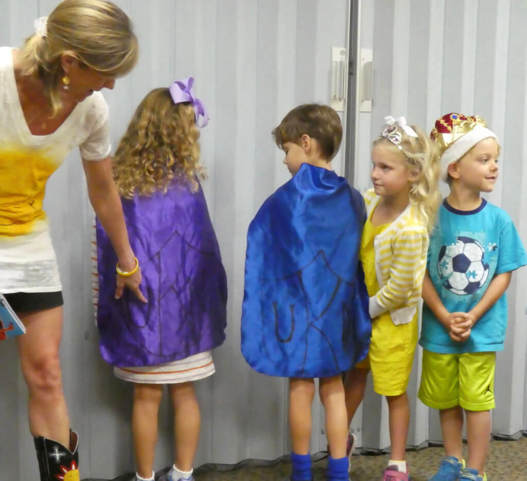 "A school visit where students wear U K-N Capes to say, ""You Can""!"